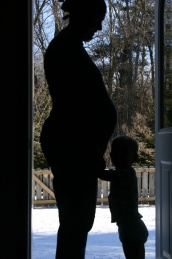 baby in belly front door w Henry