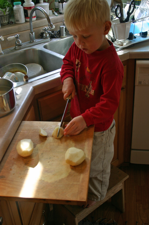 Henry cutting potatoes