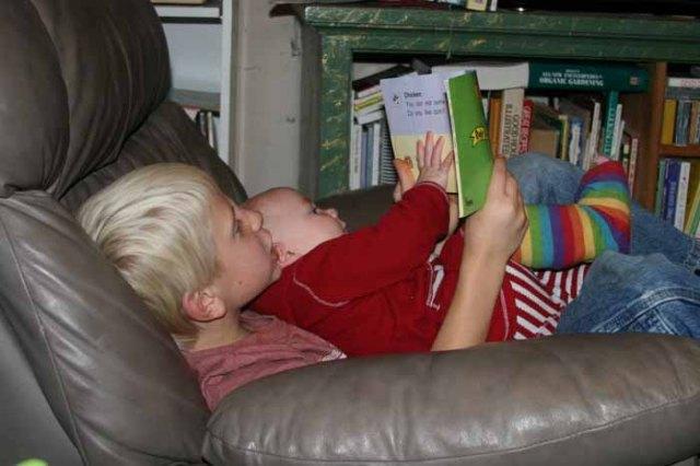 Charlie reading to Nola Mae