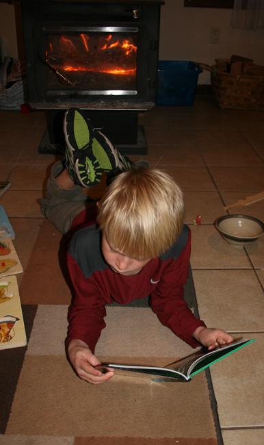 Robbie reading on floor