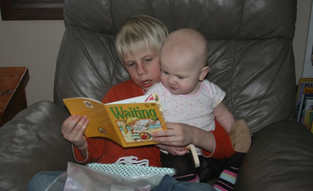 Charlie reads to Nola Mae