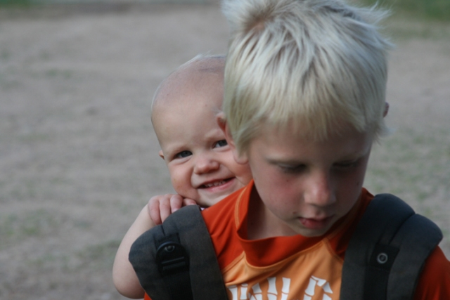 baby wearing sibling Ergo Charlie