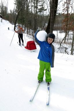 skiing Charlie snowball