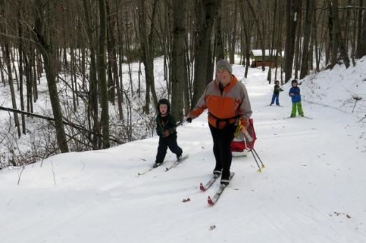Ski family pulling Henry