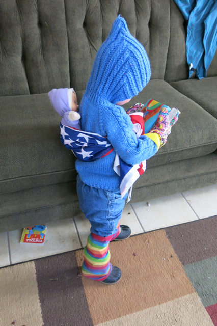 babywearing doll with flag