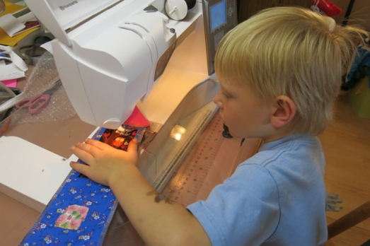 Henry sewing for granny