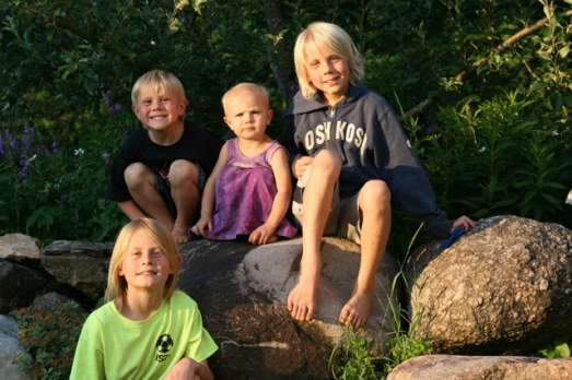 four kids on rocks