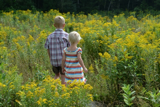 henry and Nola Mae in yellow weeds