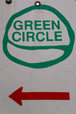 frugal sisters green circle sign a